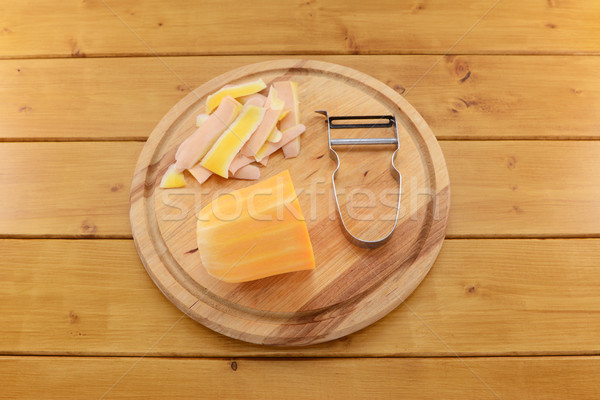 Butternut squash with a vegetable peeler on a chopping board Stock photo © sarahdoow