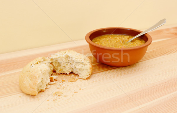 Soup served with a torn crusty bread roll Stock photo © sarahdoow