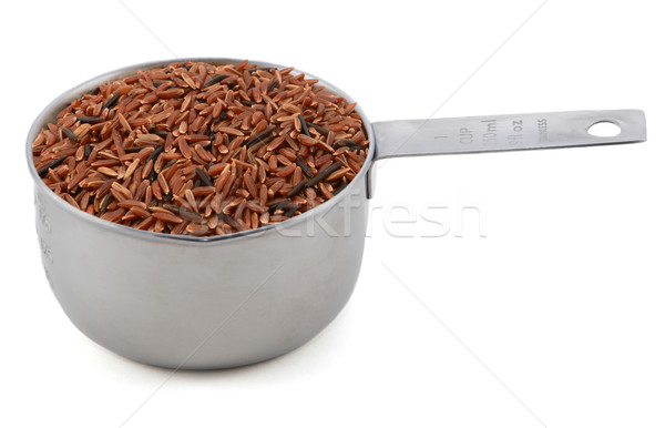 Camargue red rice grains in a cup measure Stock photo © sarahdoow