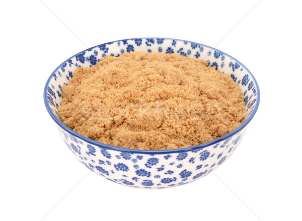 Light muscovado sugar in a blue and white china bowl Stock photo © sarahdoow