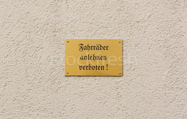 German sign forbids leaning of bikes against the wall Stock photo © sarahdoow