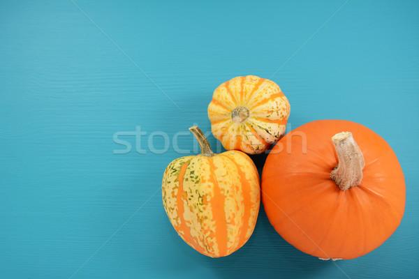 Oranje pompoen squash geschilderd Blauw houten Stockfoto © sarahdoow