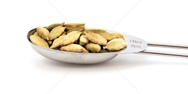Cardamom pods measured in a metal tablespoon Stock photo © sarahdoow