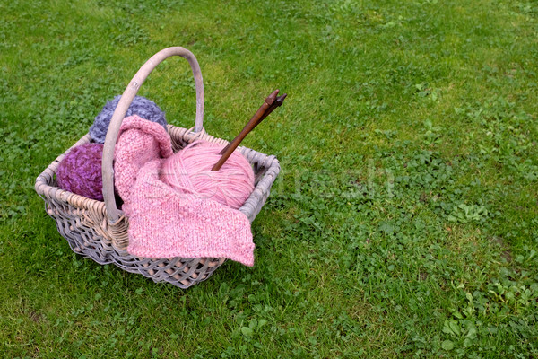 Basket of knitting, needles and wool on a lawn Stock photo © sarahdoow
