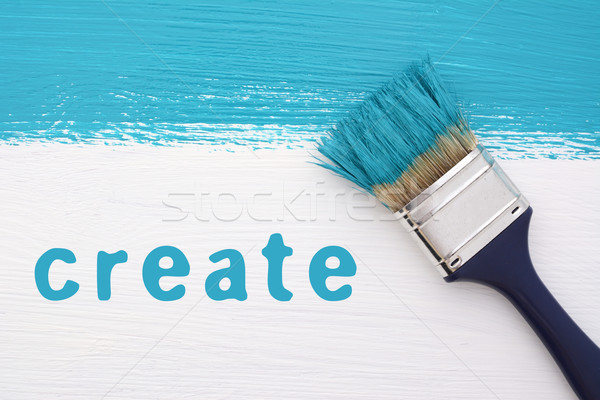 Stripe of turquoise paint, paintbrush and the word CREATE Stock photo © sarahdoow