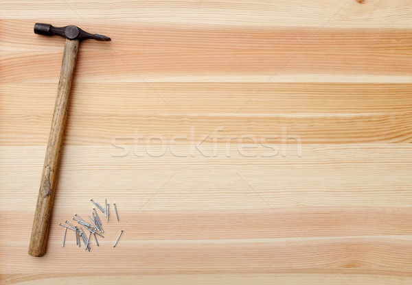 Hammer and metal panel pins on a woodgrain background Stock photo © sarahdoow