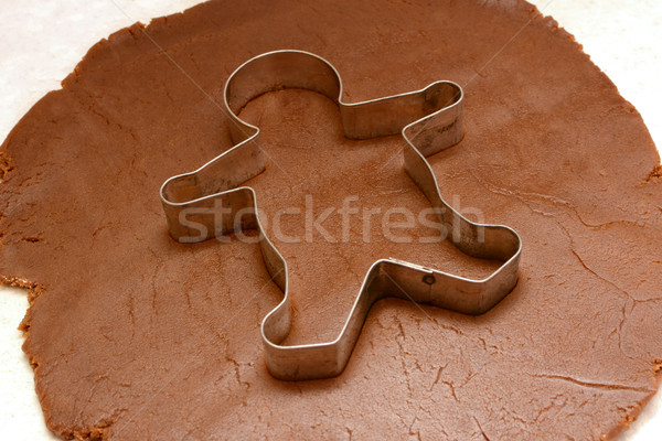 Gingerbread man cutter on cookie dough Stock photo © sarahdoow
