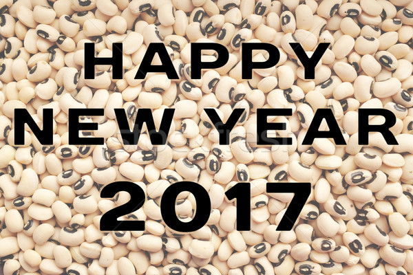 Happy New Year 2017 text over black eyed peas Stock photo © sarahdoow