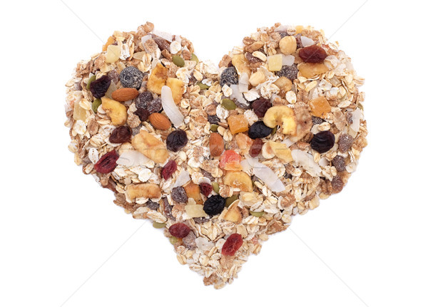 Muesli cereal, seeds, mixed fruit and nuts heart Stock photo © sarahdoow
