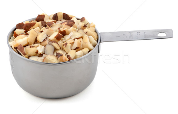 Chopped brazil nuts in a metal cup measure Stock photo © sarahdoow
