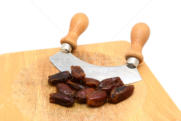 Whole dates with a rocking knife  Stock photo © sarahdoow