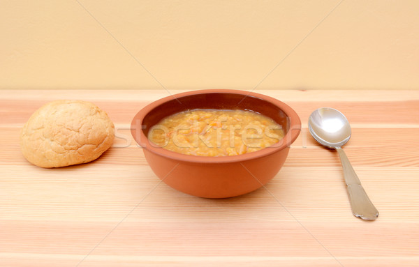 Hearty lentil soup served with a crusty bread roll Stock photo © sarahdoow