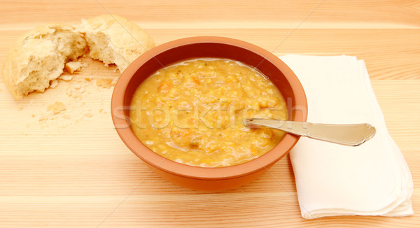 Soup on a table with a torn bread roll Stock photo © sarahdoow