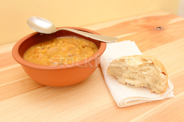 Bowl of soup, with a half-eaten bread roll on a serviette  Stock photo © sarahdoow