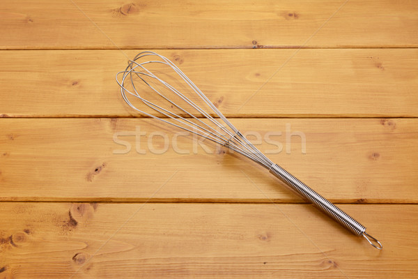 Metal whisk on a table Stock photo © sarahdoow