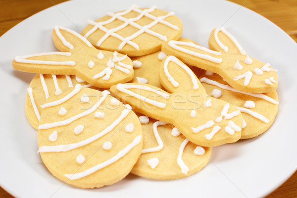 Heap of frosted Easter biscuits on a plate Stock photo © sarahdoow