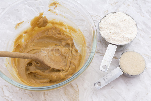 Cups of flour and sugar with peanut butter mixture Stock photo © sarahdoow