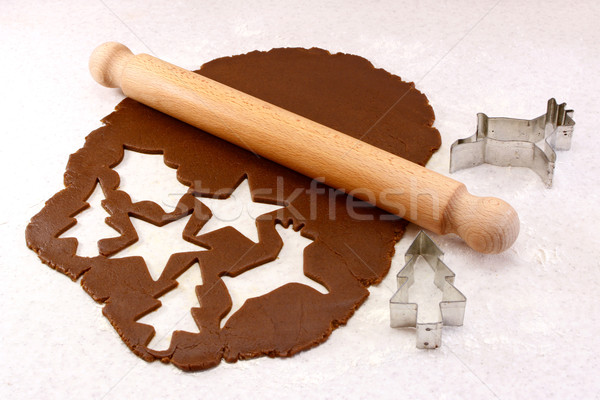 Rolling pin and festive cookie cutters with gingerbread dough Stock photo © sarahdoow