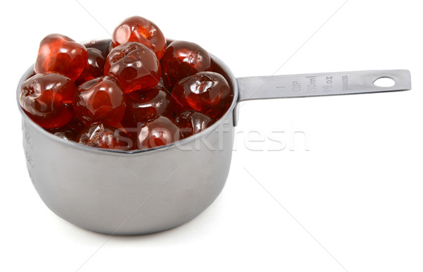 Sticky whole glace cherries in a cup measure Stock photo © sarahdoow