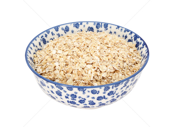 Porridge oats in a blue and white china bowl Stock photo © sarahdoow