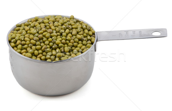 Stock photo: Green mung beans in a measuring cup
