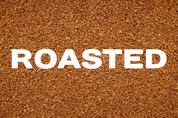 ROASTED text across instant coffee granules background Stock photo © sarahdoow