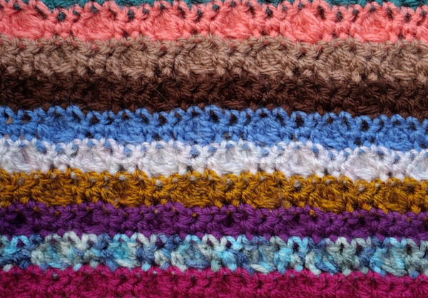 Background of crocheted stitches in multi-coloured stripes Stock photo © sarahdoow
