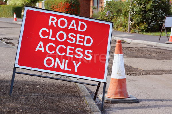 ROAD CLOSED ACCESS ONLY road sign with a traffic cone Stock photo © sarahdoow
