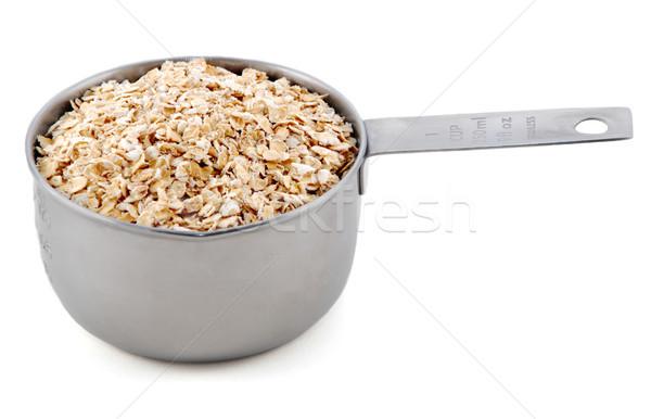Porridge oats presented in an American metal cup measure Stock photo © sarahdoow