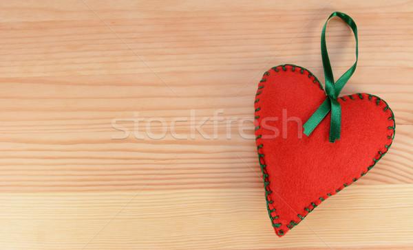 Heart-shaped felt decoration with green ribbon  Stock photo © sarahdoow