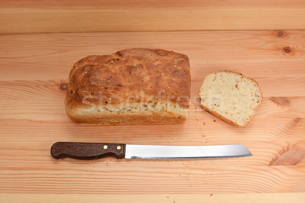 Fresh loaf of bread with a cut slice Stock photo © sarahdoow