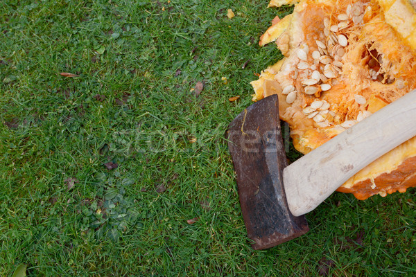 Sharp axe against a large pumpkin, hacked open Stock photo © sarahdoow