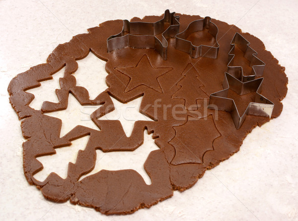 Gingerbread dough cutout shapes and biscuit cutters Stock photo © sarahdoow