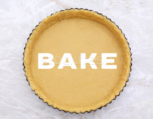 Flan tin lined with shortcrust pastry - BAKE text Stock photo © sarahdoow