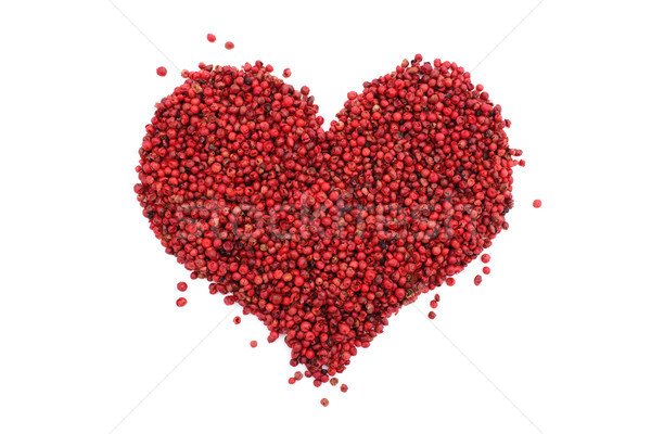 Pink peppercorns in a heart shape Stock photo © sarahdoow