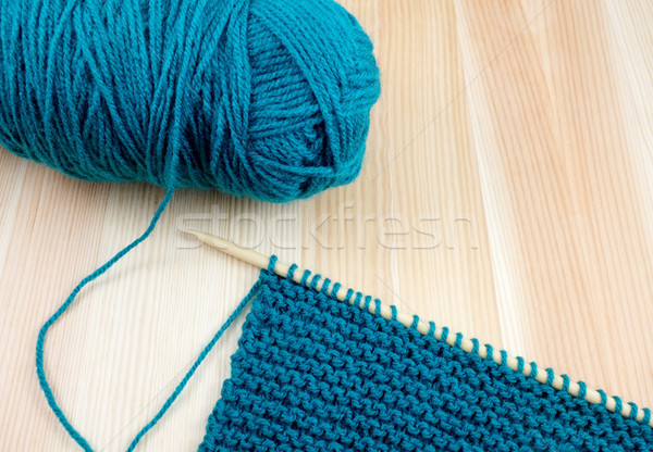 Ball of blue wool with knitting on the needle Stock photo © sarahdoow