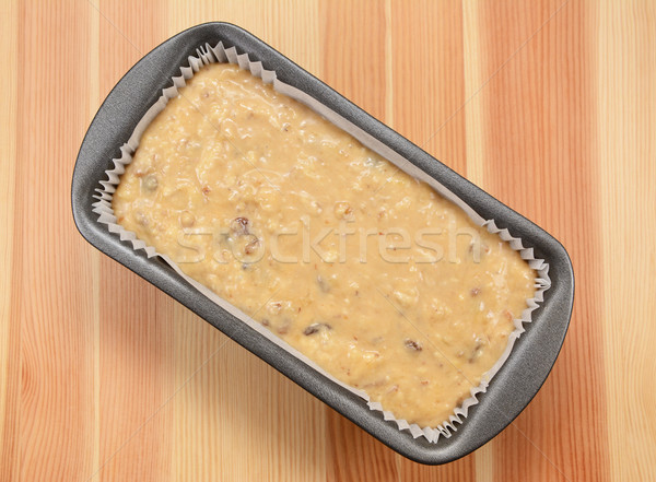 Raw banana loaf batter in a lined tin  Stock photo © sarahdoow