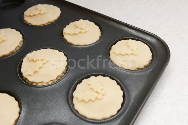 Mince pies in a bun tin ready for the oven Stock photo © sarahdoow