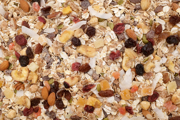 Muesli background - mixed fruit and nuts with cereal flakes Stock photo © sarahdoow