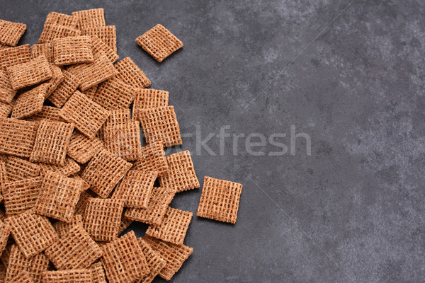 Malted shredded wheat biscuits breakfast cereal on grey slate ba Stock photo © sarahdoow
