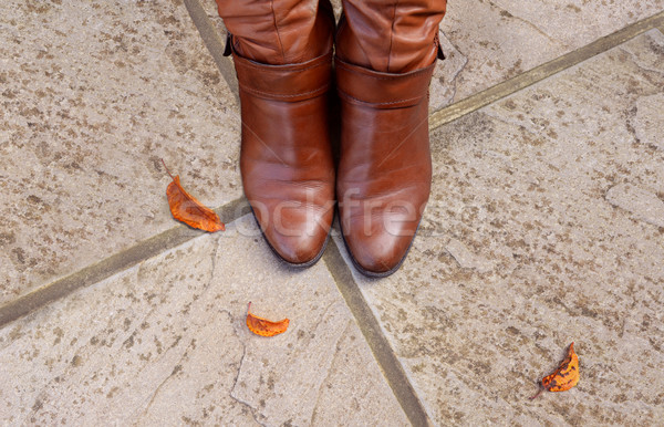 Toes of tan leather boots on a concrete  Stock photo © sarahdoow
