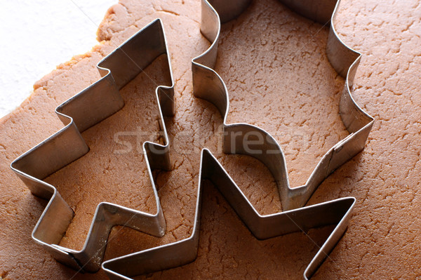 Festive cookie cutters on gingerbread dough Stock photo © sarahdoow