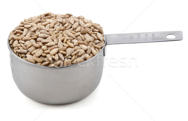 Hulled sunflower seeds in a cup measure Stock photo © sarahdoow