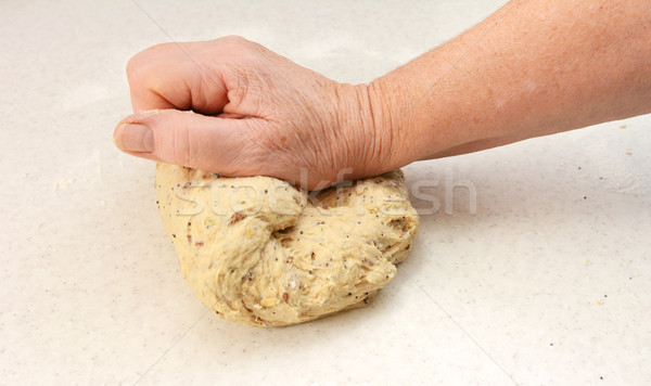 Woman kneading bread dough by hand Stock photo © sarahdoow