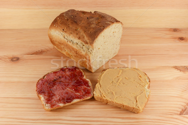 Cut loaf of fresh bread with jelly and peanut butter slices Stock photo © sarahdoow