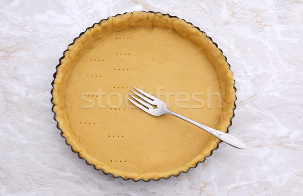 Pricking shortcrust pastry case with a metal fork Stock photo © sarahdoow