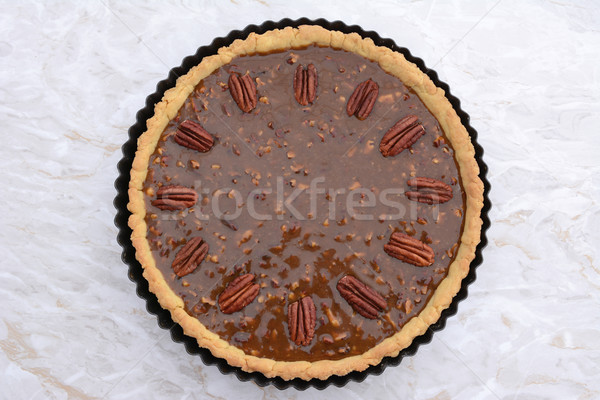 Pecan pie decorated with nuts ready to be baked Stock photo © sarahdoow