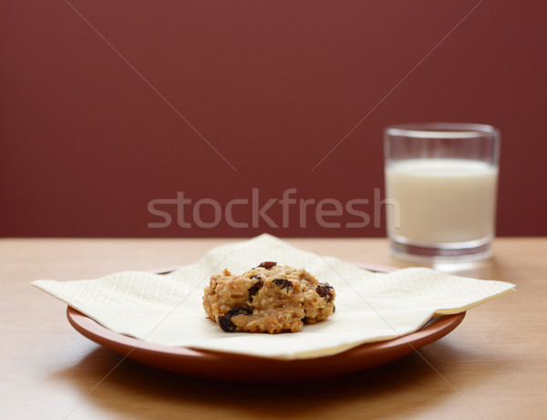 Stock photo: Oatmeal raisin cookie with a glass of milk