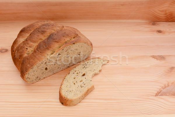 Pão pão tabela cortar fatia mesa de madeira Foto stock © sarahdoow