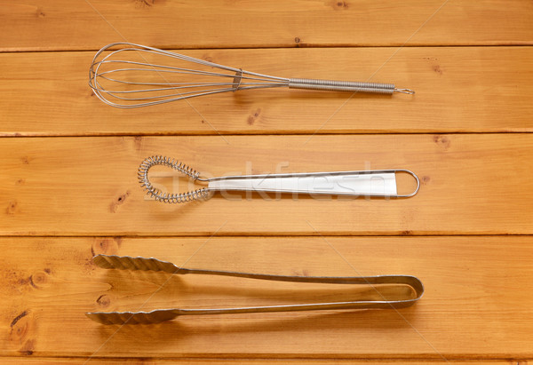 Balloon and sauce whisks and metal tongs Stock photo © sarahdoow